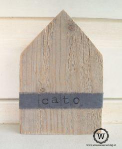steigerhouten huis met naam